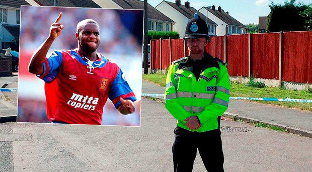 Dalian Atkinson, inset, a police officer stands guard outside the estate where the incident occurred