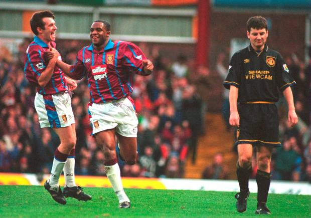 Ray Houghton and Dalian Atkinson celebrate after Atkinson scored against Manchester United