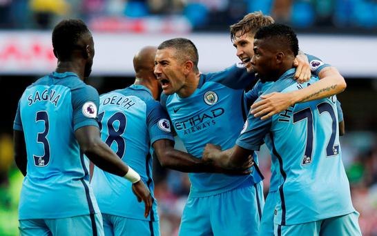 Manchester City's Aleksandar Kolarov celebrates Sunderland's Paddy McNair scoring a own goal and their second at the weekend
