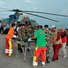 Nepalese army personnel assist a victim of a bus accident after being airlifted from Birtadeurali in Kavre to Kathmandu, Nepal, August 15, 2016. Nepalese Army/Handout via REUTERS