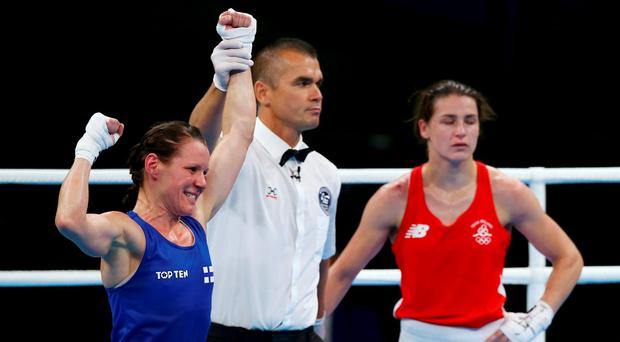 Mira Potkonen (FIN) of Finland celebrates after winning her bout against Katie Taylor (IRL) of Ireland. REUTERS/Peter Cziborra
