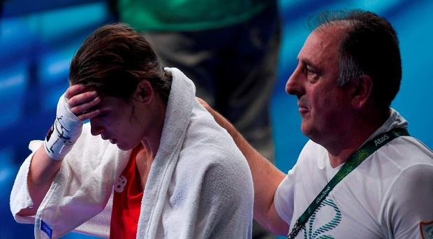 Katie Taylor of Ireland is consoled by Team Ireland coach Zaur Antia after her defeat to Mira Potkonen of Finland in their Lightweight quarter-final bout in the Riocentro Pavillion 6 Arena, Barra da Tijuca, during the 2016 Rio Summer Olympic Games in Rio de Janeiro, Brazil. Photo by Ramsey Cardy/Sportsfile