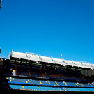 Stamford Bridge stadium is pictured in the late afternoon sunshine ahead of the English Premier League football match between Chelsea and West Ham United. / AFP PHOTO