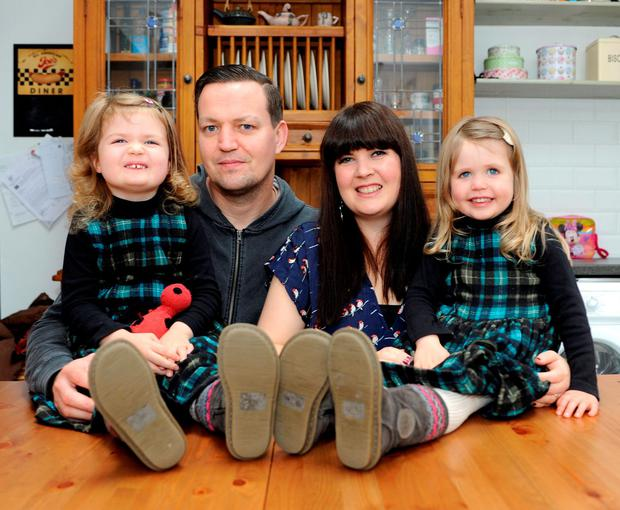 Sadhbh Devlin, pictured with her husband Mark and their twin girls Sábha and Lile (6), says she won't be purchasing the new 'Mr Men' series for her daughters. Photo: Dave Meehan