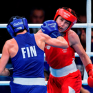 Katie Taylor on the receiving end of a right hand during her defeat to Mira Potkonen. Photo by Ramsey Cardy/Sportsfile