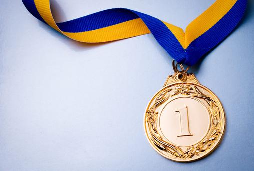 Patrick picked up a Gold medal for U10 handwriting. Stock image: Depositphotos