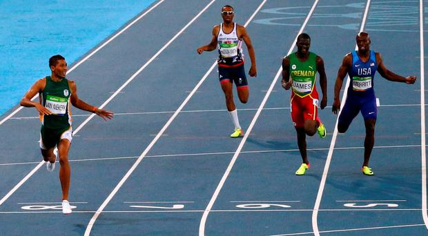 Van Niekerk finishes well ahead of his opponents to win the 400M gold, setting a new world record. Photo: Reuters