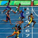 Bolt wins his third consecutive summer Olympics 100M Gold. Photo: Reuters