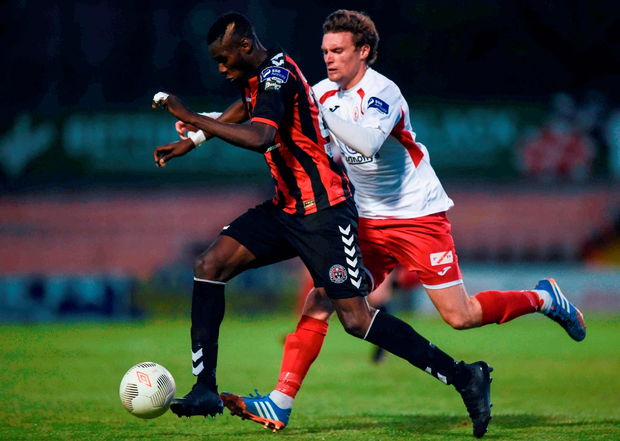 Ismahil Akinade of Bohemians in action against Michael Leahy of Sligo Rovers. Photo: David Fitzgerald/Sportsfile