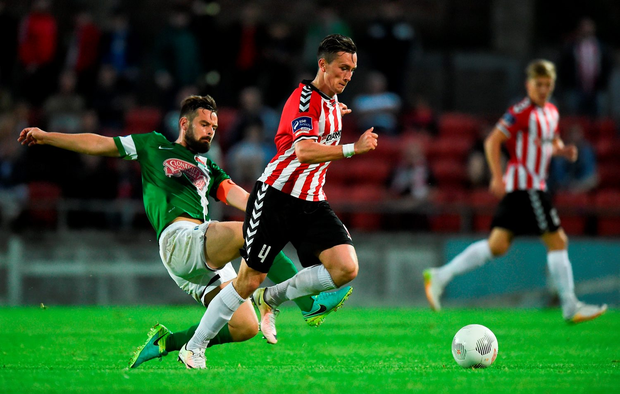 Aaron McEneff of Derry City in action against Greg Bolger of Cork City. Photo: David Maher/Sportsfile
