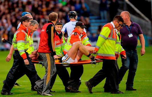 Michael Fennelly of Kilkenny leaves the field on a stretcher after picking up an injury during the GAA Hurling All-Ireland Senior Championship Semi-Final Replay game between Kilkenny and Waterford at Semple Stadium in Thurles, Co Tipperary. Photo by Piaras Ó Mídheach/Sportsfile