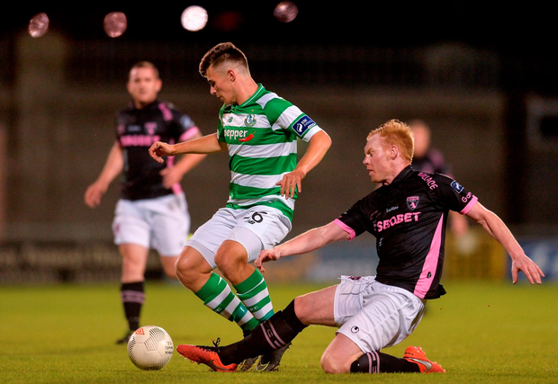 Aaron Dobbs of Shamrock Rovers in action against Stephen Last of Wexford Youths. Photo: Eóin Noonan/Sportsfile