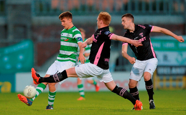 Sean Boyd of Shamrock Rovers in action against Stephen Last, centre, and Craig McCabe of Wexford Youths. Photo: Eóin Noonan/Sportsfile