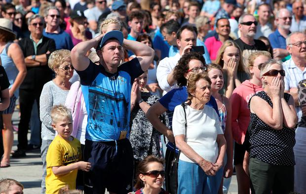 People on the seafront in Bray, Co Wicklow, react as they watch the result on a big screen Photo: Damien Eagers