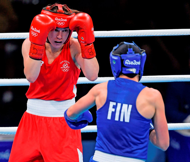 Taylor (in red) and Potkonen in action during the bout Photo: Ramsey Cardy/Sportsfile