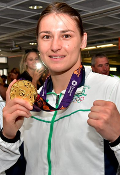 Katie Taylor holding up her gold medal on her return from the 2015 Baku European Games Photo: Cody Glenn / SPORTSFILE