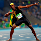 Usain Bolt strikes his signature pose. Photo: Getty