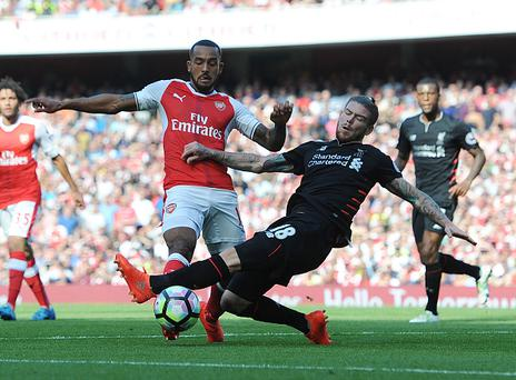 LONDON, ENGLAND - AUGUST 14: Theo Walcott of Arsenal tripped by Liverpool defender Alberto Moreno during the Premier League match between Arsenal and Liverpool at Emirates Stadium on August 14, 2016 in London, England. (Photo by Stuart MacFarlane/Arsenal FC via Getty Images)