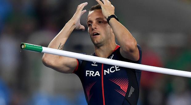 RIO DE JANEIRO, BRAZIL - AUGUST 15: Renaud Lavillenie of France reacts while competing in the Men's Pole Vault final on Day 10 of the Rio 2016 Olympic Games at the Olympic Stadium on August 15, 2016 in Rio de Janeiro, Brazil. (Photo by Shaun Botterill/Getty Images)