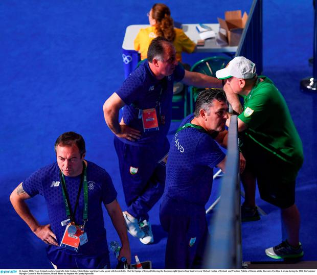Team Ireland coaches, from left, John Conlan, Eddie Bolger and Zaur Antia speak with Kevin Kilty, Chef de Equipe of Ireland following the Bantamweight Quarterfinal bout between Michael Conlan of Ireland and Vladimir Nikitin of Russia. Photo by Stephen McCarthy/Sportsfile