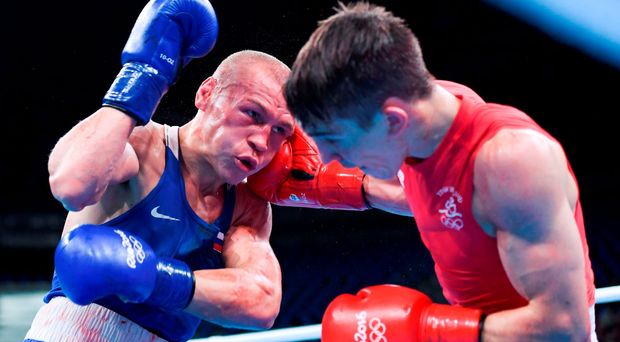 Vladimir Nikitin of Russia, left, exchanges punches with Michael Conlan of Ireland during their Bantamweight quarter final bout Photo by Stephen McCarthy/Sportsfile