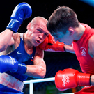 Vladimir Nikitin of Russia, left, exchanges punches with Michael Conlan during their Bantamweight quarter final bout in the Rio 2016 Olympic Games. Photo: Stephen McCarthy/Sportsfile
