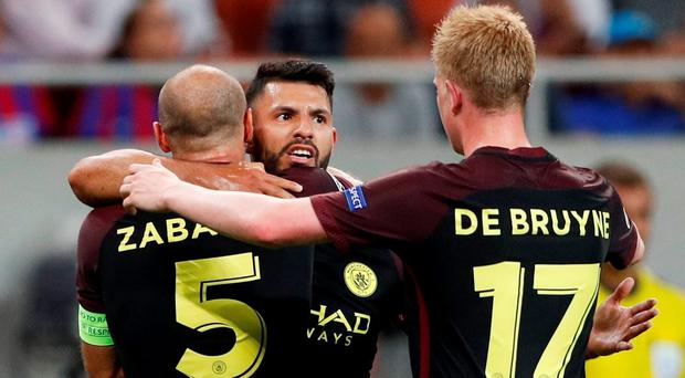 Manchester City's Sergio Aguero celebrates scoring their second goal with Pablo Zabaleta and Kevin De Bruyne. Photo: John Sibley/Action Images via Reuters