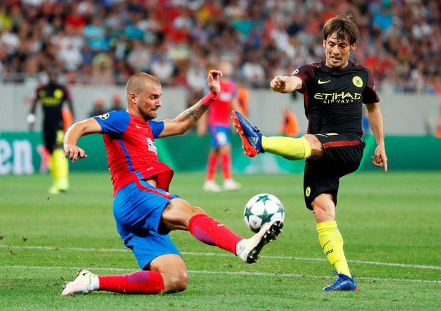 Manchester City's David Silva in action with Steaua Bucharest's Gabriel Tamas. Photo: John Sibley/Action Images via Reuters