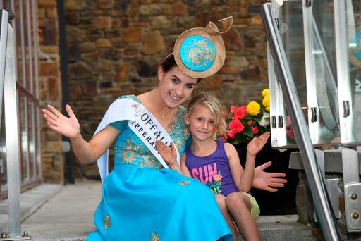 Offaly Rose Emma Kirwan is greeted by local girl Zara Mannix as she arrives in Kerry for the festival. Emma will be getting her Leaving Cert results today. Photo: Domnick Walsh