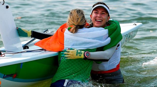 Annalise Murphy hugs sailing partner Sarah Winther. Photo by Brendan Moran/Sportsfile