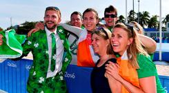 Annalise Murphy celebrates with her brother Finn (left), mother Cathy McAleavey and sister Claudine (right of picture) after claiming the silver medal. Photo by Brendan Moran/Sportsfile