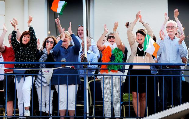 Supporters at the National Yacht Club in Dún Laoghaire cheer her success. Pic Steve Humphreys