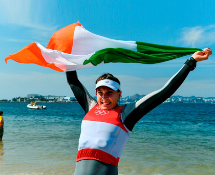 Ireland's Annalise Murphy celebrates after winning silver in the women's laser radial medal race. Photo: Brendan Moran/Sportsfile