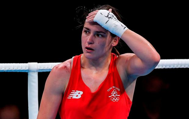 Katie Taylor reacts after her defeat to Mira Potkonen in their Lightweight quarter-final bout. Photo by Ramsey Cardy/Sportsfile