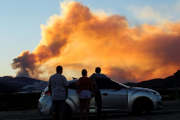 People watch the so-called Blue Cut wildfire in Lytle Creek, California, August 16, 2016