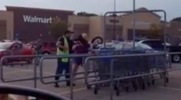 A monkey jumps on a man in a Wal-Mart car park Credit: Facebook / Richelle Stewart