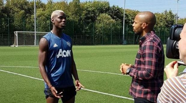 Paul Pogba chats with Thierry Henry. Credit: Sky Sports