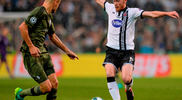 17 August 2016; Chris Shields of Dundalk FC in action against Adam Hlousek of Legia Warsaw during the UEFA Champions League Play Off 1st Leg match between Dundalk FC and Legia Warsaw at Dublin Arena in Dublin. Photo by Eóin Noonan/Sportsfile