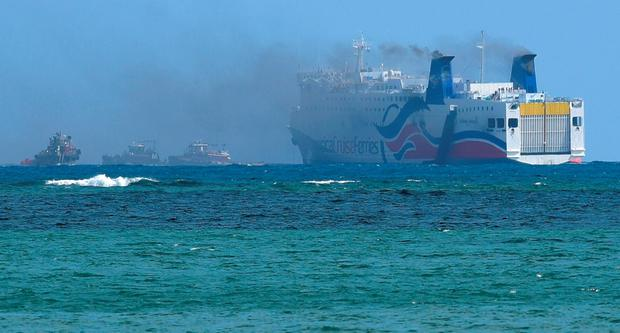 Smokes spills from the the cruise ship Caribbean Fantasy off the coast of San Juan, Puerto Rico, Wednesday, Aug. 17, 2016. (AP Photo/Carlos Giusti)