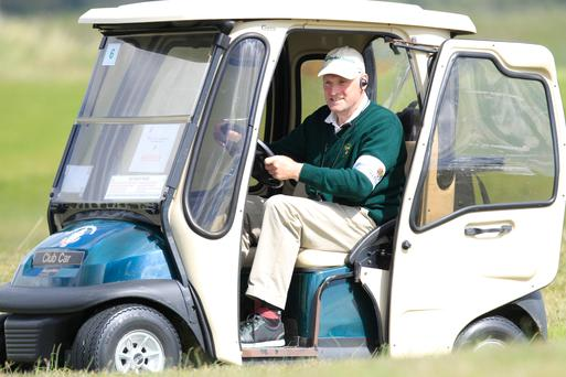 Jim Mooney checking scores during the final round of the 2015 Irish Boys Amateur Open Championship at Tuam. Picture: Thos Caffrey/www.golffile.ie