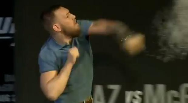 Conor McGregor firing a water bottle at Nate Diaz and his crew