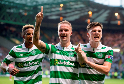Celtic's Leigh Griffiths celebrates scoring his side's third goal of the game with teammate Kieran Tierney during the UEFA Champions League qualifying play-off, first leg match at Celtic Park, Glasgow. PRESS ASSOCIATION Photo.