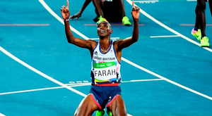 Mo Farah falls to his knees after crossing the line to win the 10,000m. Photo: Matthias Hangst/Getty Images