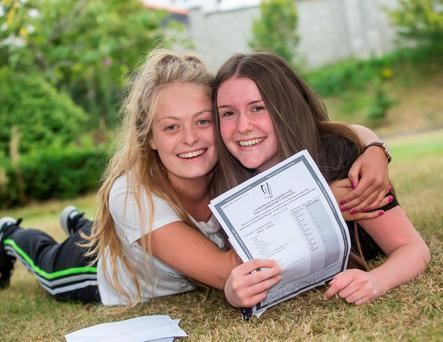 Ciara Murphy (left) and Sarah Lewis celebrate after getting their results. Photo: Pat Moore Photo: Pat Moore.