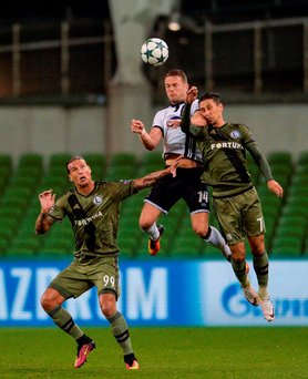 Dane Massey of Dundalk FC in action against Mihail Alexandrov, right, and Aleksandar Prijovic of Legia Warsaw. Photo: Eóin Noonan/Sportsfile