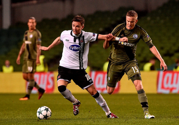 Ronan Finn of Dundalk FC in action against of Nemanja Nikolić of Legia Warsaw. Photo: David Maher/Sportsfile