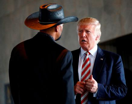 Donald Trump talks to local sheriff David Clarke Jr during a visit to the Milwaukee County War Memorial Center in Wisconsin. Photo: Eric Thayerinci