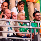 Sports Minister Shane Ross (on left) watches Scott Evans' match in the last 16 of the men's badminton in Rio de Janeiro. Photo: Stephen McCarthy/Sportsfile