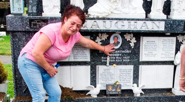 Helen Maughan beside the desecrated grave of her son Michael at Boharnabreena Cemetry today. Pic: Colin O'Riordan