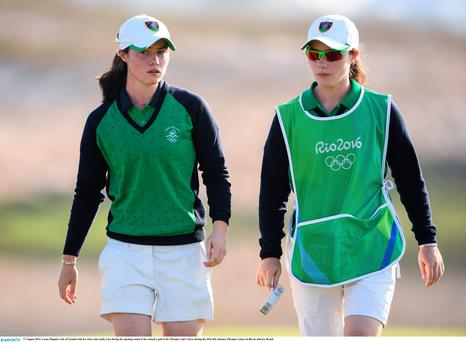 Leona Maguire, left, of Ireland with her sister and caddy Lisa during the opening round of the women's golf at the Olympic Golf Course during the 2016 Rio Summer Olympic Games in Rio de Janeiro, Brazil.
